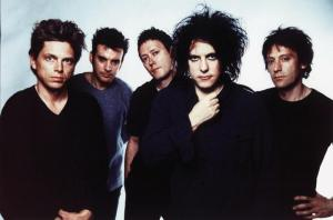 By the '90s, Robert Smith should have probably started looking into a different look...